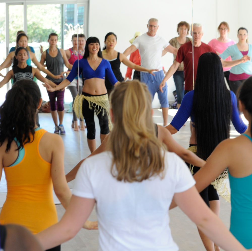 Teacher instructs Open House participants in belly dance