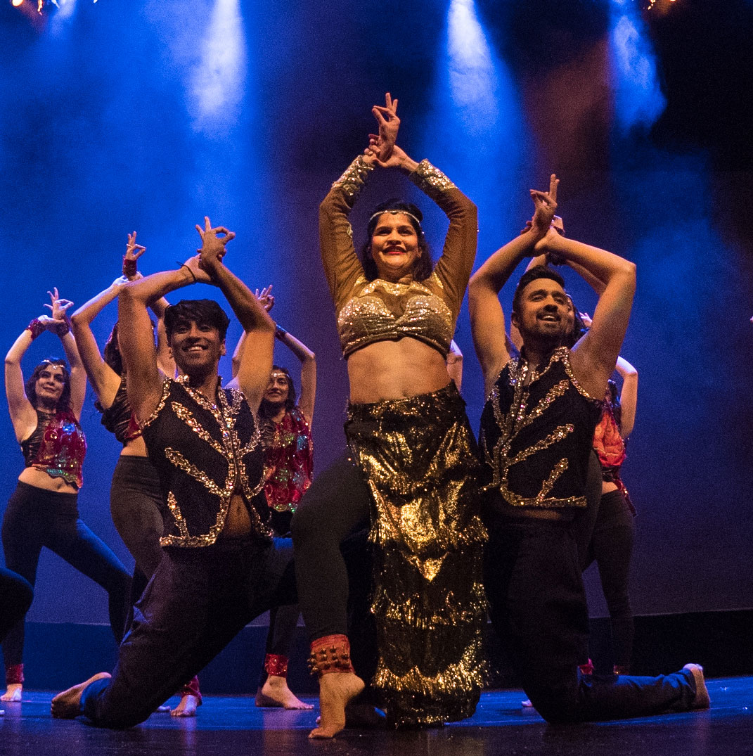 Dance artists from Shiamak's Bollywood Jazz pose mid performance