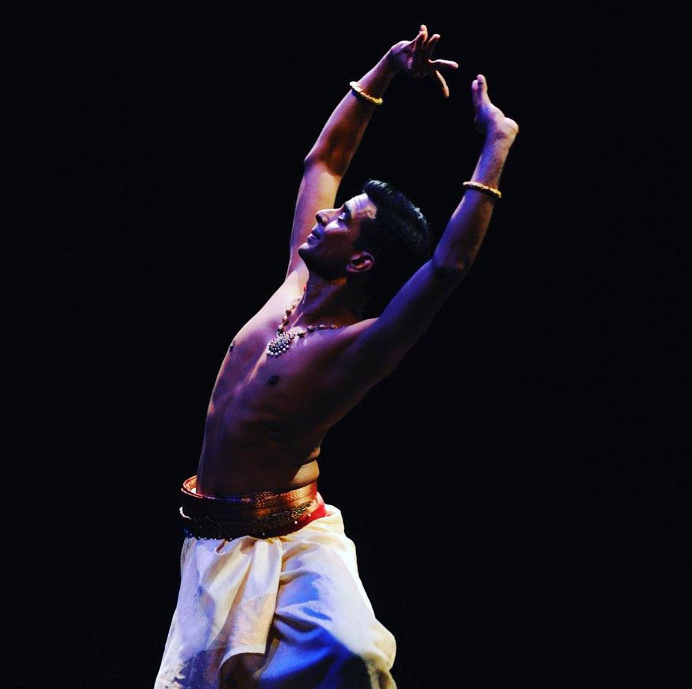 Dance artist Sujit Vaidya poses mid performance