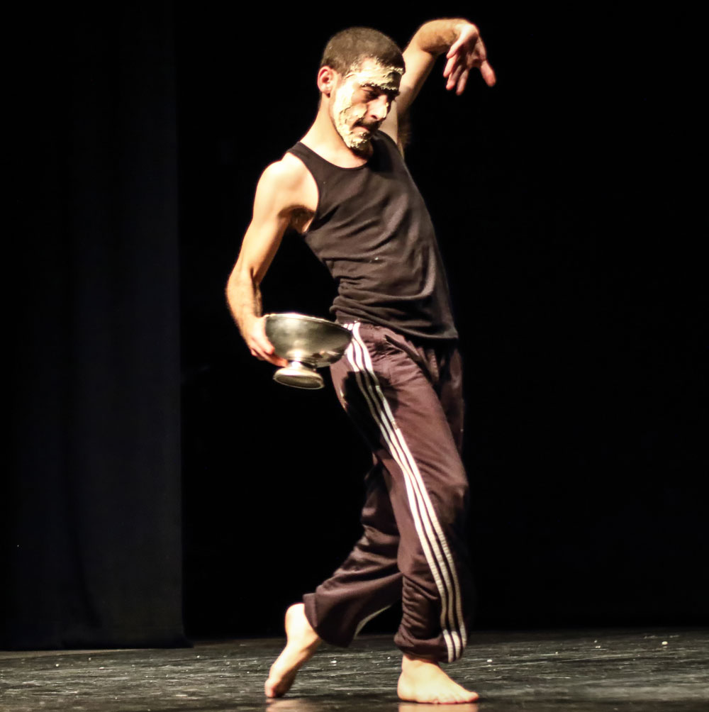 Dance artist Adi Boutrous poses mid performance