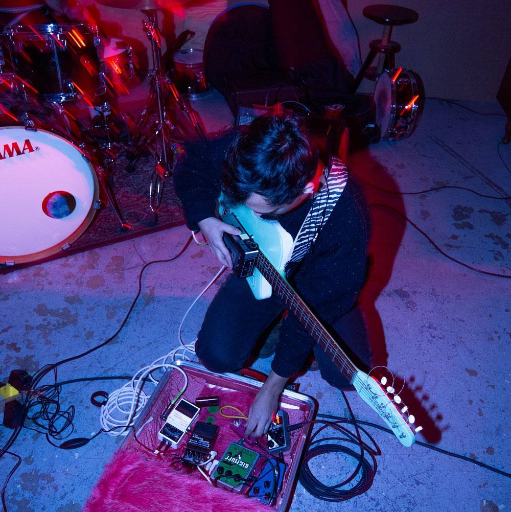 Musician Matthew Ariaratnam plays guitar