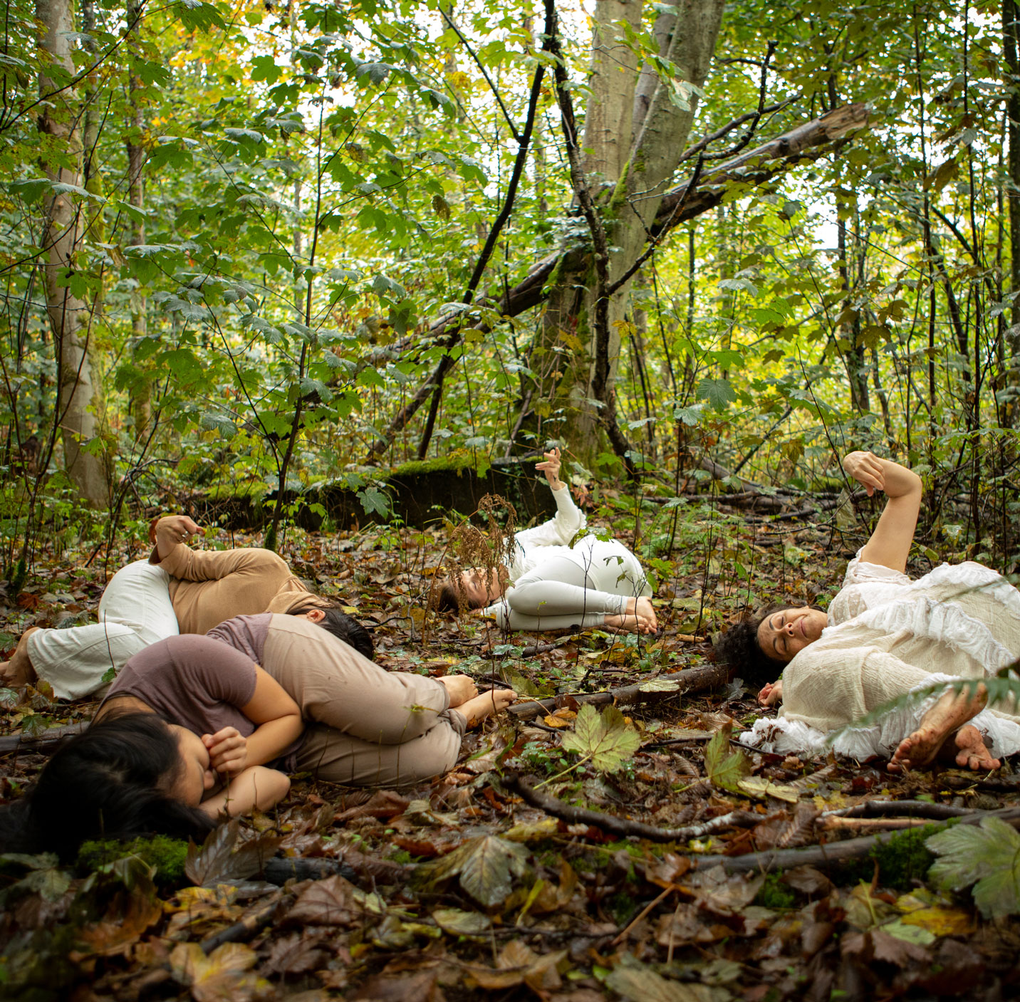 dance artists from Raven Spirit Dance Society perform in a forest