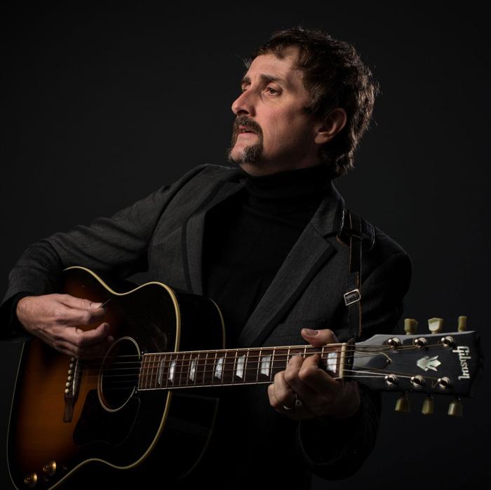 Marc Stewart plays guitar