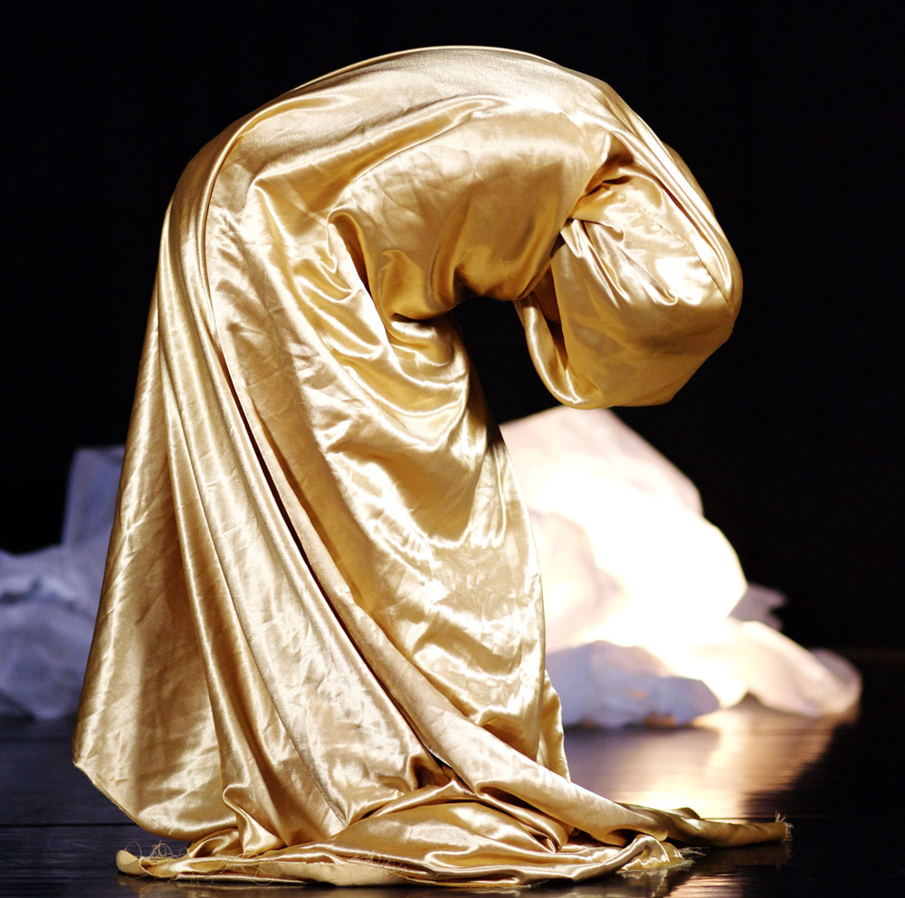 Zahra Shahab in performance with gold fabric wrapped around her