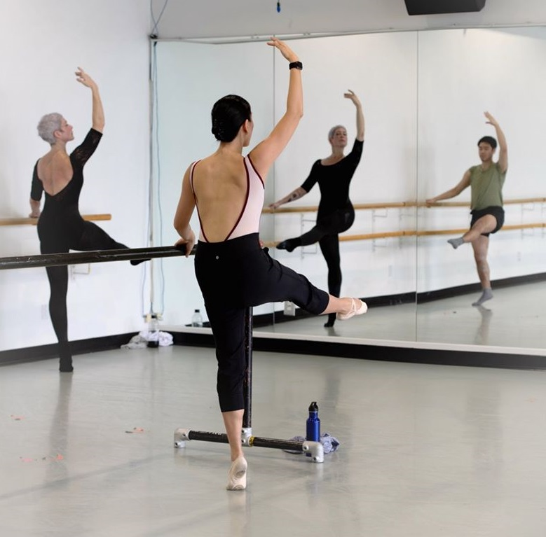 Dancers pose during Linda Arkelian's dance class