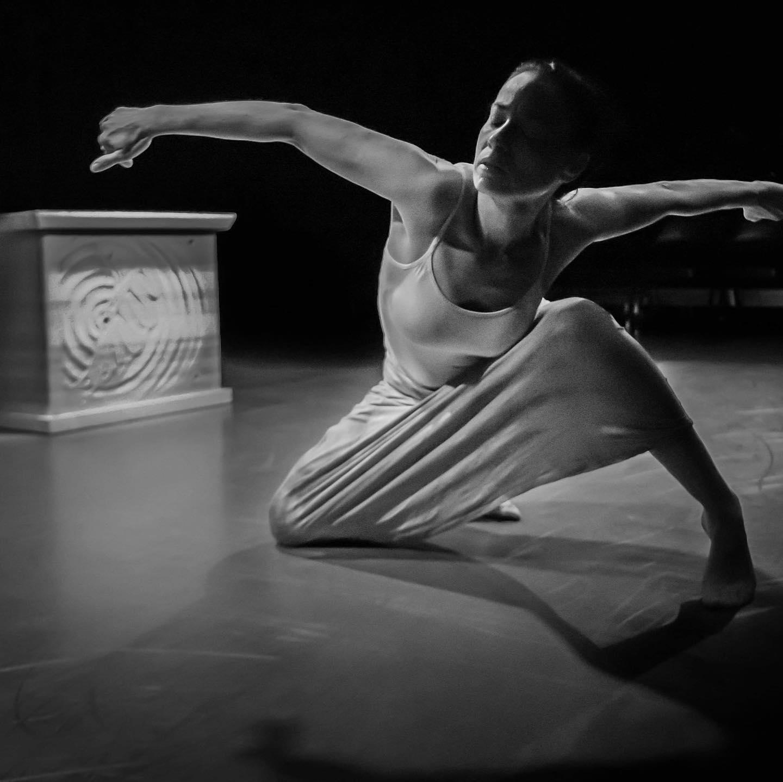 Dance artist Tasha Faye Evans poses mid performance