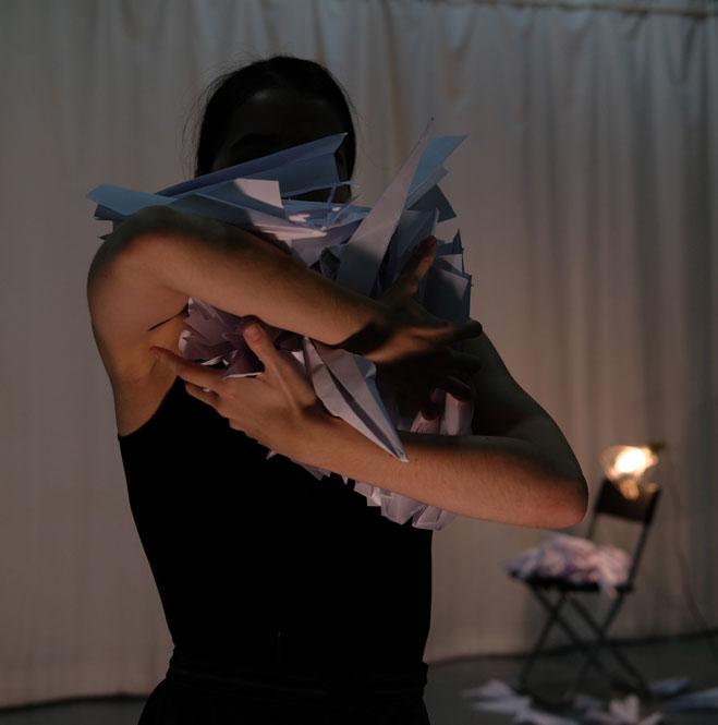 Dance artist Daria Mikhaylyukg poses mid performance