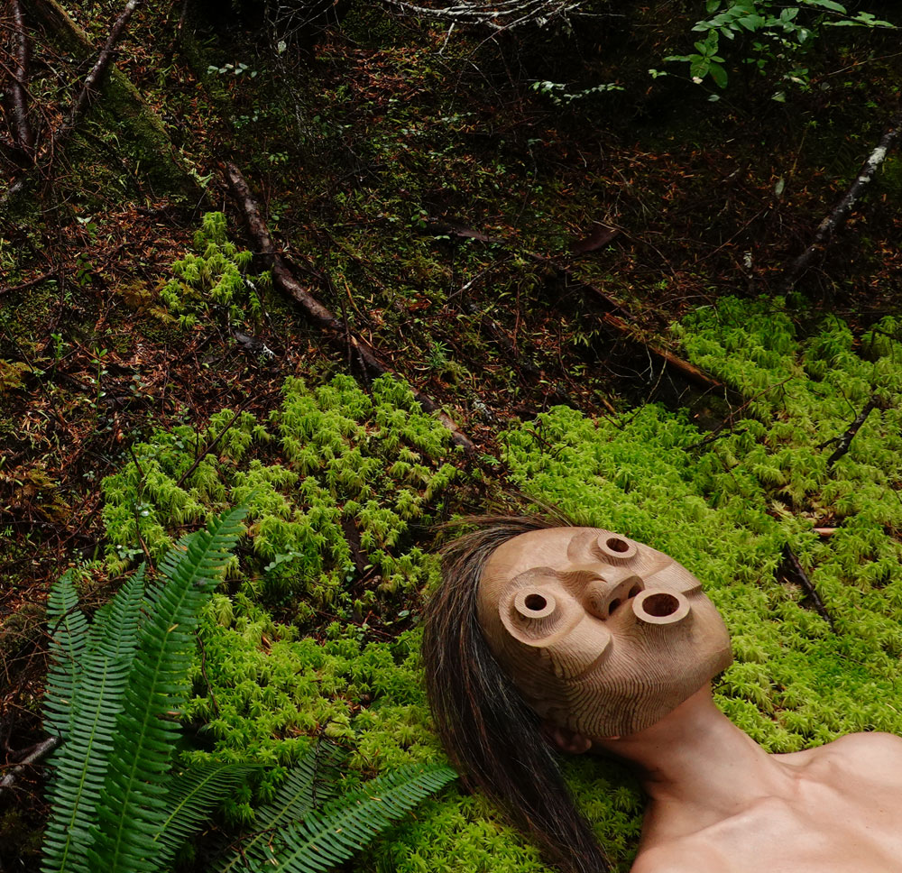 Indigenous mask lying in the forest