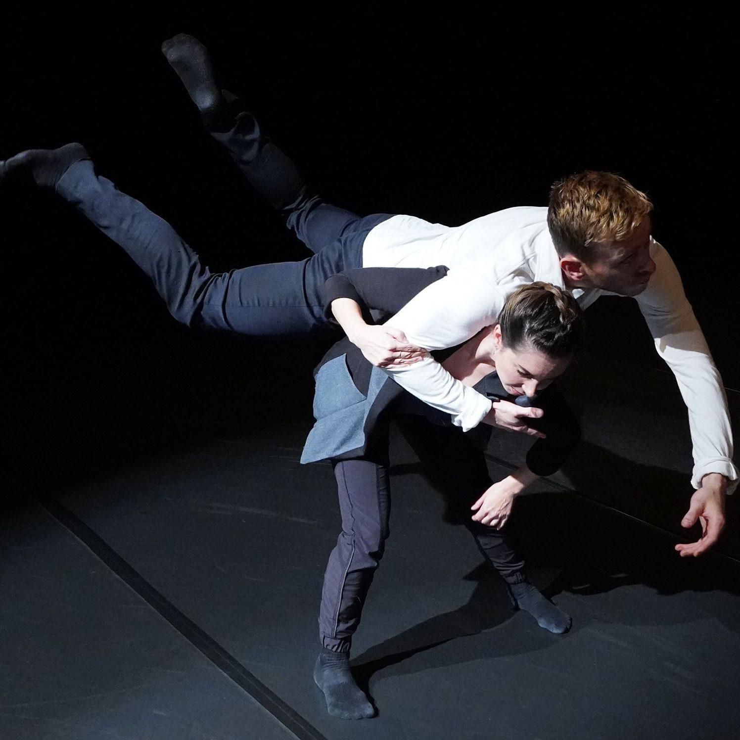 Racheal Prince and Brandon Lee Alley pose mid performance