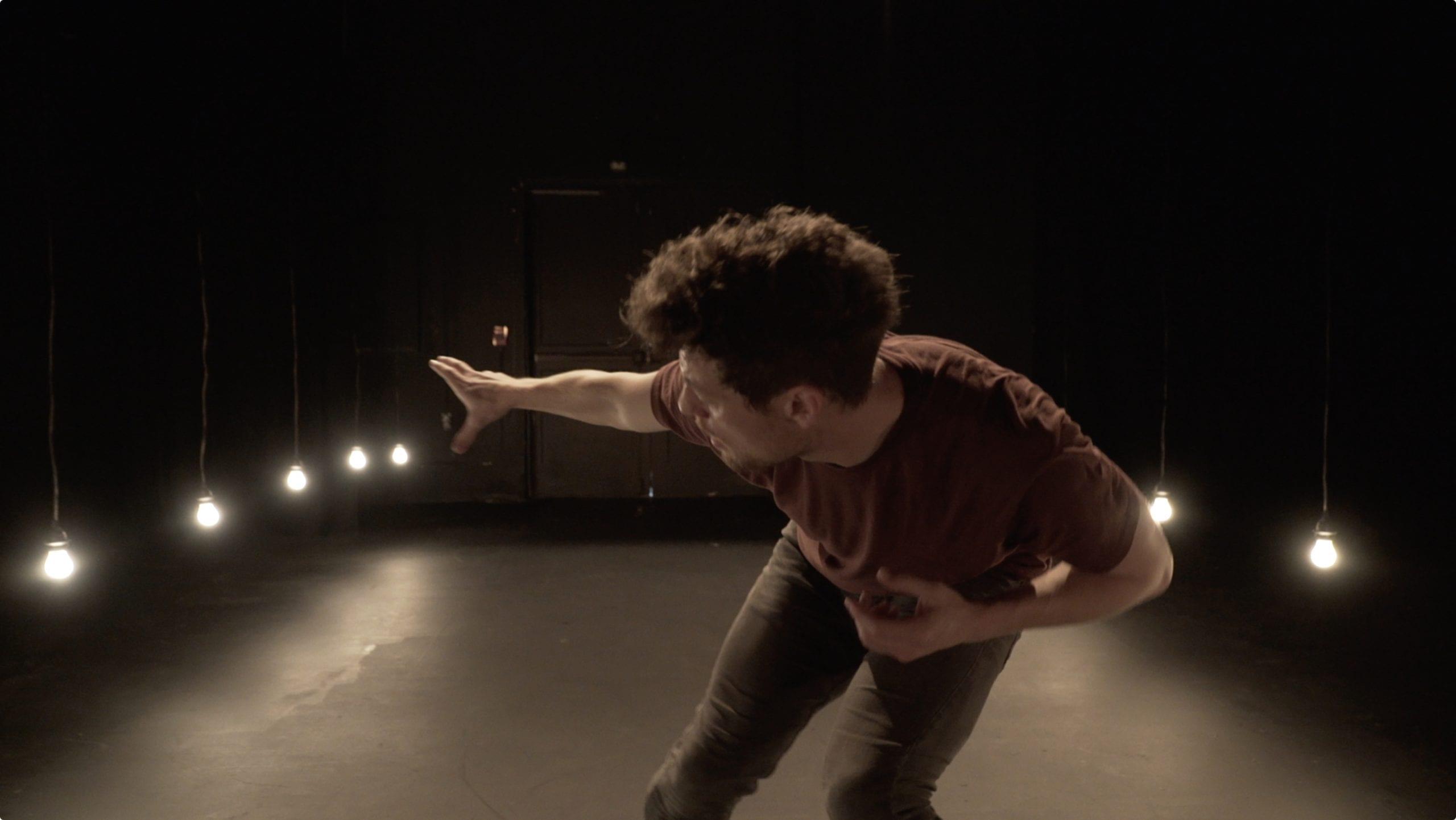 Screenshot of Josh Martin from Company 605 leaning forward, mid performance