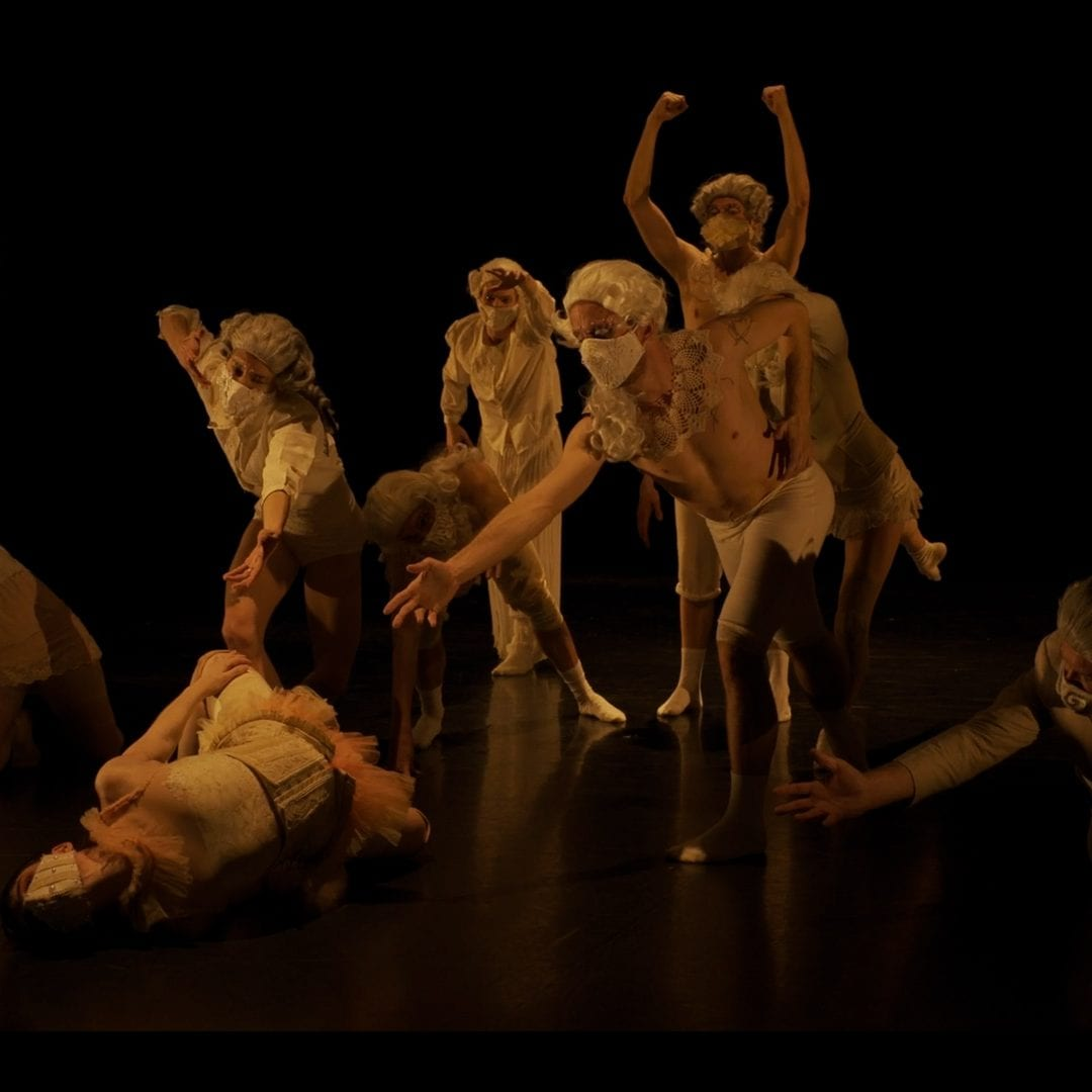 Screenshot of studio showing of Orfeo ed Euridice featuring dancers in costume, wigs and masks while performing in the Faris Family Studio