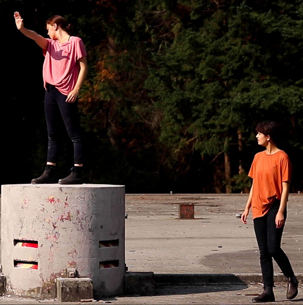 Dance artists perform in an industrial lot