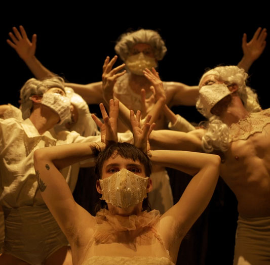 Screenshot of Orfeo ed Euridice featuring dancers in costume, wigs and masks while performing in the Faris Family Studio