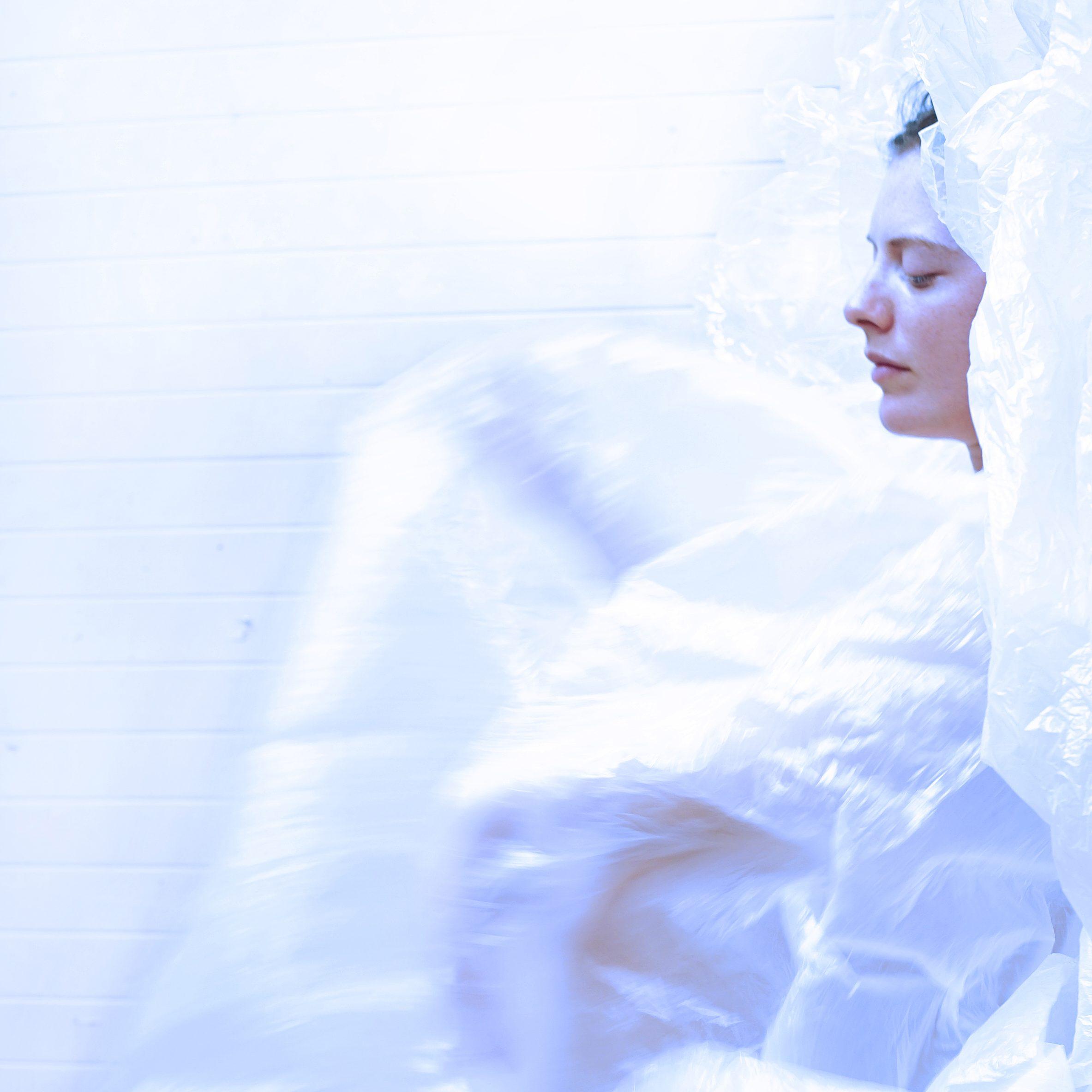 Dance artist Kellie McInnes covered in bubble wrap